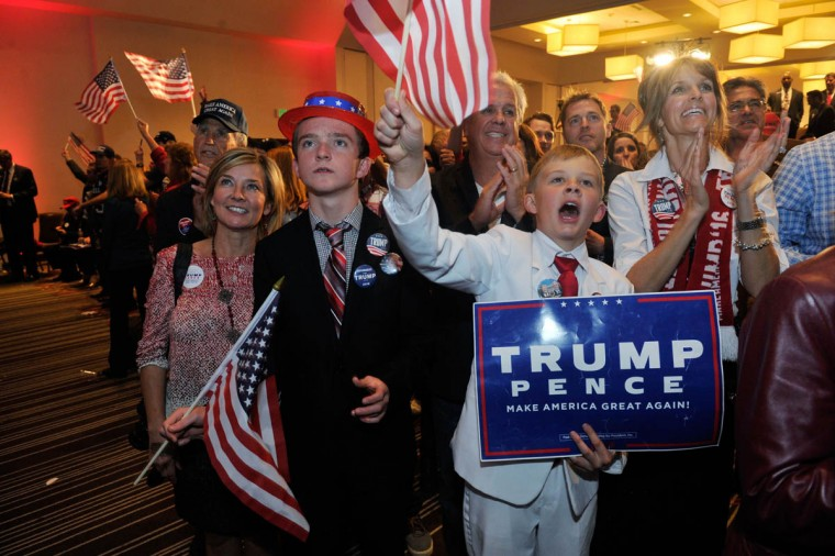 Supporters of Republican presidential nominee Donald Trump celebrate after Trump was declared as the winner of the US election while attending the Colorado GOP Election Night Party in Greenwood Village, Colorado on November 8, 2016. Donald Trump has stunned America and the world, riding a wave of populist resentment to defeat Hillary Clinton in the race to become the 45th president of the United States. / AFP PHOTO / Jason Connolly