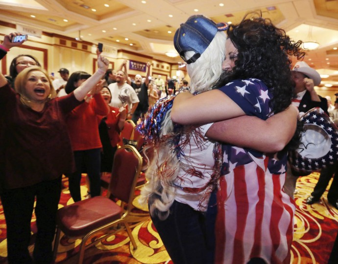 Diana Caldon, right, embraces Stephanie Smith in celebration at an election night watch party hosted by the Nevada GOP as Donald Trump wins the presidency Tuesday, Nov. 8, 2016, in Las Vegas. (AP Photo/Ronda Churchill)