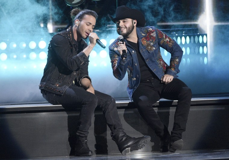 "Prince Royce, left, and Gerardo Ortiz perform ""Moneda""at the 17th annual Latin Grammy Awards at the T-Mobile Arena on Thursday, Nov. 17, 2016, in Las Vegas. (Photo by Chris Pizzello/Invision/AP)"