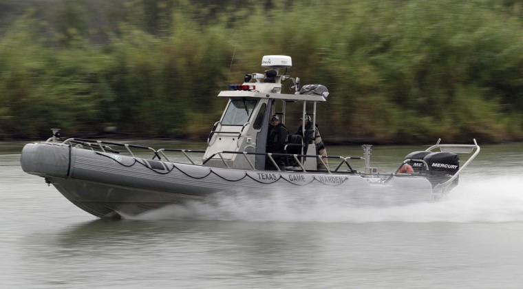 In this Sunday, Nov. 13, 2016, photo, a Texas Parks and Wildlife boat patrols along the Rio Grande near Granjeno, Texas. (AP Photo/Eric Gay)