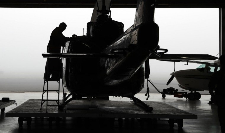 In this Tuesday, Nov. 15, 2016, photo, U.S. Air and Marine prepare a Huey for a mission to search for immigrants who entered the county illegally, in McAllen, Texas. (AP Photo/Eric Gay)