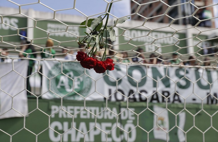 Flowers hang from a soccer net at the Arena Conda stadium where fans of the Brazilian soccer team Chapecoense began gathering, in Chapeco, Brazil, Tuesday, Nov. 29, 2016. A chartered plane that was carrying the Brazilian soccer team to the biggest match of its history crashed into a Colombian hillside and broke into pieces, Colombian officials said Tuesday. (AP Photo/Andre Penner)