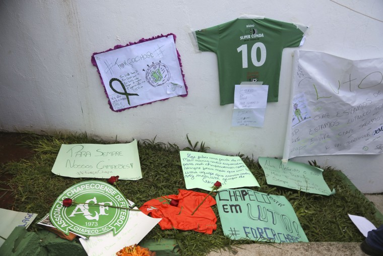 Messages left by fans are part of a makeshift memorial for members of the Chapecoense soccer team outside the Arena Conda stadium in Chapeco, Brazil, Tuesday, Nov. 29, 2016. A chartered plane that was carrying the Brazilian soccer team to the biggest match of its history crashed into a Colombian hillside and broke into pieces, Colombian officials said Tuesday. (AP Photo/Andre Penner)