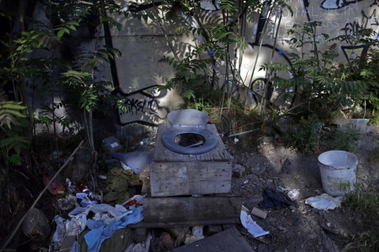 In this Oct. 10, 2016 photo, the toilet used by street children sits in a ruined building, in Santiago, Chile. Many if not all of the youths living in the ruin were once wards of the state, living in shelters of National Service for Minors. (AP Photo/Luis Hidalgo)