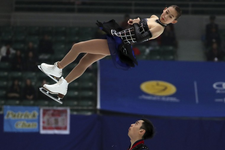 Peng Cheng and Jin Yan of China compete in the Pairs Short Program during the Audi Cup of China ISU Grand Prix of Figure Skating 2016 held in Beijing's Capital Gymnasium on Friday, Nov. 18, 2016. (AP Photo/Ng Han Guan)