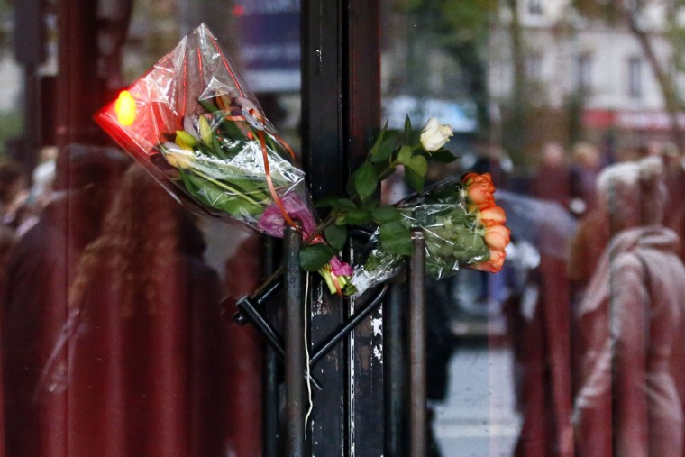 Bouquets of roses rest on the door of the Bataclan concert hall in Paris, Sunday, Nov. 13, 2016, after a ceremony held for the victims of last year's Paris attacks, which targeted the hall as well as a series of bars and killed 130 people (AP Photo/Francois Mori)