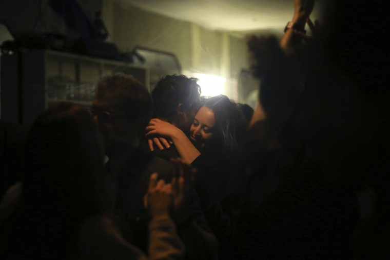 A couple dance at the Carillon Hotel in Paris, Sunday, Nov. 13, 2016. France marked the anniversary of Islamic extremists' coordinated attacks on Paris with a somber silence on Sunday that was broken only by voices reciting the names of the 130 slain, and the son of the first person to die stressing the importance of integration. (AP Photo/Thibault Camus)