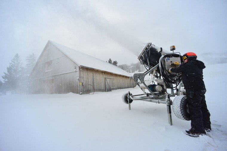 Brendan Ryan, director of project management at Mt. Snow, in Dover, Vt., operates a snow gun on Monday, Nov. 21, 2016. New England ski areas are rejoicing in the recent snow ahead of the traditional start to the season. (Kristopher Radder/Brattleboro Reformer via AP)