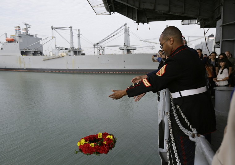 A wreath is tossed off the fantail of the USS Hornet Museum during a Veterans Day ceremony Friday, Nov. 11, 2016, in Alameda, Calif. The Essex-class carrier is known for its service in World War II and the recoveries of the Apollo 11 and 12 lunar capsules after astronauts walked on the moon. (AP Photo/Eric Risberg)