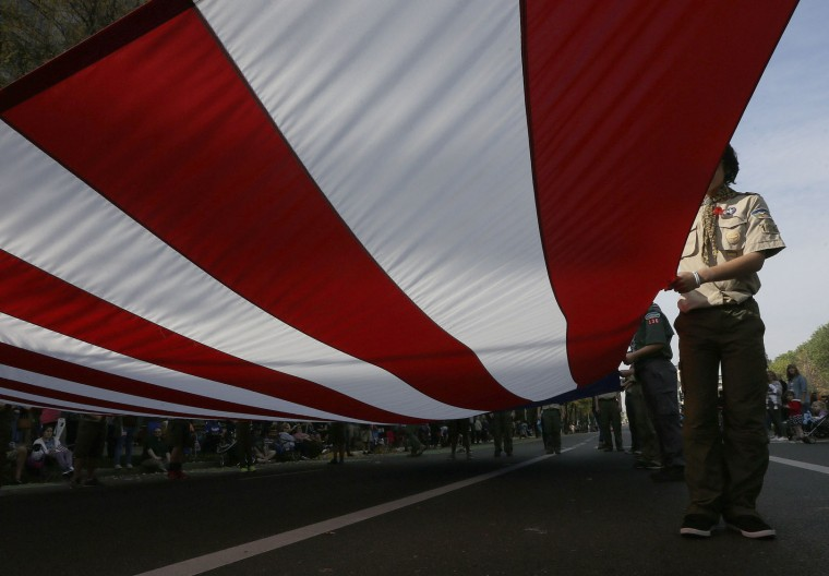 A United States flag is carried down Capitol Mall during a Veterans Day Parade in Sacramento, Calif., Friday, Nov. 11, 2016. (AP Photo/Rich Pedroncelli)