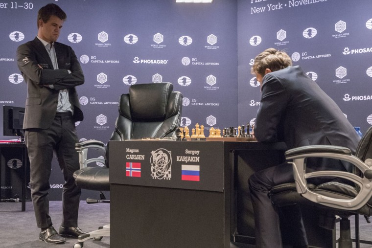 Chess world champion Magnus Carlsen, left, of Norway, and challenger Sergey Karjakin, of Russia, study the board during the first round of the World Chess Championship, Friday, Nov. 11, 2016, in New York. (AP Photo/Mary Altaffer)