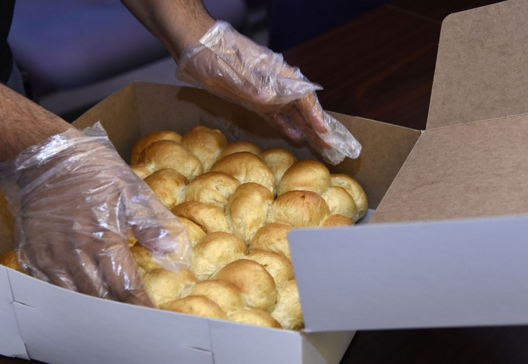 "Rolls being boxed at The Avenue Bakery. Thanksgiving means making hundreds of dozens of ""Poppay's"" yeast dinner rolls at The Avenue Bakery on Pennsylvania Avenue in the Druid Heights neighborhood. (Barbara Haddock Taylor/Baltimore Sun)"