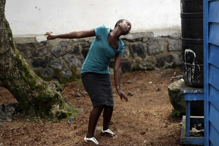 In this photo taken on Sunday, June 19, 2016, Jeannette Umutesi dances in the courtyard at the En Avant Les Enfants INUKA center in Goma, Democratic Republic of Congo. Born only a few years after Rwanda's 1994 genocide spilled into Congo and rebellions started forming, Jeannette has known only Congo's and her father's violence, displacement and death. (AP Photo/Jerome Delay)