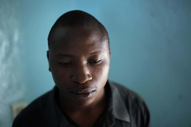 In this photo taken on Monday, June 20, 2016, Damien Matata Bizi, 22, recounts his past as an orphan who became a child soldier at the Don Bosco center in Goma, Democratic Republic of Congo. Bizi became a rebel aged 10 after his father, also an armed fighter, died.(AP Photo/Jerome Delay)