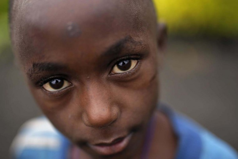 In this photo taken on Tuesday, June 21, 2016, Moises Munoka, seven, recounts the loss of his mother who died in 2013 after health complications from rapes, at the Children's voice center in Goma, Democratic Republic of Congo. More than four million children have lost at least one parent in Congo over the past two decades. (AP Photo/Jerome Delay)