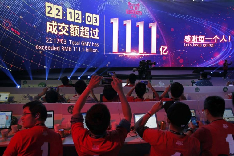 """A giant screen showing a total sales transacted of e-commerce giant Alibaba, as the gross merchandise value has exceeded RMB 111.1 billion (US$16.3 billion) on the """"Singles' Day"""" global online shopping festival in Shenzhen, southern China's Guangdong province Friday, Nov. 11, 2016. In a bright spot for China's cooling economy, online shoppers spent billions of dollars Friday on """"Singles' Day,"""" a quirky holiday that has grown into the world's busiest day for e-commerce. (AP Photo/Kin Cheung)"""