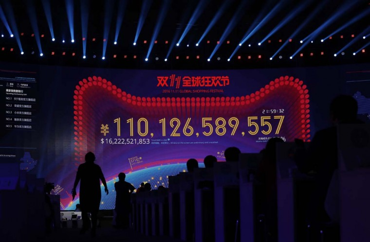 """A giant screen showing a total sales transacted of e-commerce giant Alibaba, on the """"Singles' Day"""" global online shopping festival in Shenzhen, southern China's Guangdong province Friday, Nov. 11, 2016. In a bright spot for China's cooling economy, online shoppers spent billions of dollars Friday on """"Singles' Day,"""" a quirky holiday that has grown into the world's busiest day for e-commerce. (AP Photo/Kin Cheung)"""