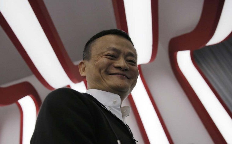 """Alibaba Group Chairman Jack Ma smiles on the """"Singles' Day"""" global online shopping festival in Shenzhen, southern China's Guangdong province Friday, Nov. 11, 2016. In a bright spot for China's cooling economy, online shoppers spent billions of dollars Friday on """"Singles Day,"""" a quirky holiday that has grown into the world's busiest day for e-commerce. (AP Photo/Kin Cheung)"""