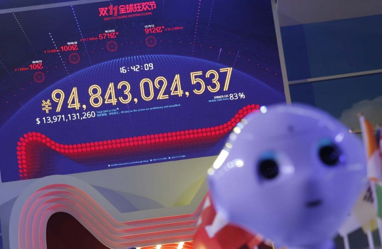 """A screen showing a total sales transacted of e-commerce giant Alibaba on the """"Singles' Day"""" global online shopping festival in Shenzhen, southern China's Guangdong province, Friday, Nov. 11, 2016. In a bright spot for China's cooling economy, online shoppers spent billions of dollars Friday on """"Singles Day,"""" a quirky holiday that has grown into the world's busiest day for e-commerce. (AP Photo/Kin Cheung)"""