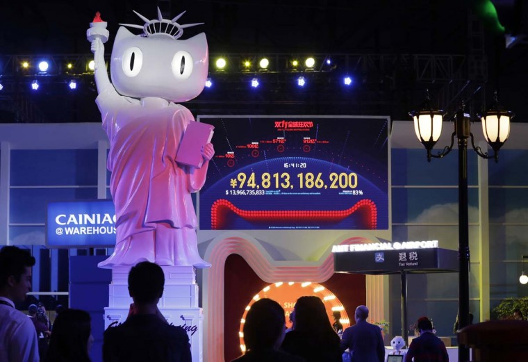 """A screen showing a total sales transacted of e-commerce giant Alibaba, on the """"Singles' Day"""" global online shopping festival in Shenzhen, southern China's Guangdong province Friday, Nov. 11, 2016. In a bright spot for China's cooling economy, online shoppers spent billions of dollars Friday on """"Singles Day,"""" a quirky holiday that has grown into the world's busiest day for e-commerce. (AP Photo/Kin Cheung)"""