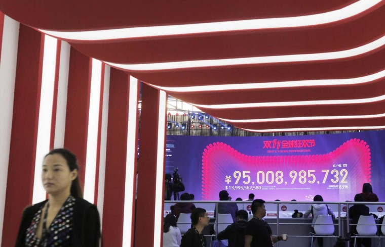 """A giant screen showing a total sales transacted of e-commerce giant Alibaba on the """"Singles' Day"""" global online shopping festival in Shenzhen, southern China's Guangdong province, Friday, Nov. 11, 2016. In a bright spot for China's cooling economy, online shoppers spent billions of dollars Friday on """"Singles Day,"""" a quirky holiday that has grown into the world's busiest day for e-commerce. (AP Photo/Kin Cheung)"""