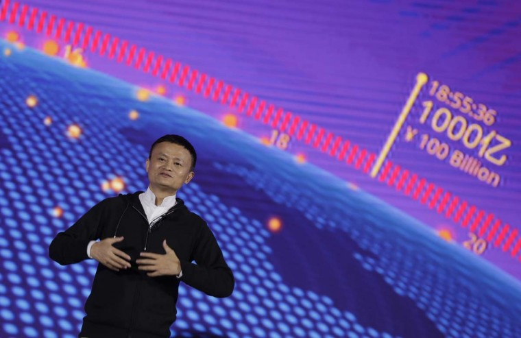 """Alibaba Group Chairman Jack Ma speaks on """"Singles Day"""" global online shopping festival in Shenzhen, southern China's Guangdong province Friday, Nov. 11, 2016. In a bright spot for China's cooling economy, online shoppers spent billions of dollars Friday on """"Singles Day,"""" a quirky holiday that has grown into the world's busiest day for e-commerce. (AP Photo/Kin Cheung)"""
