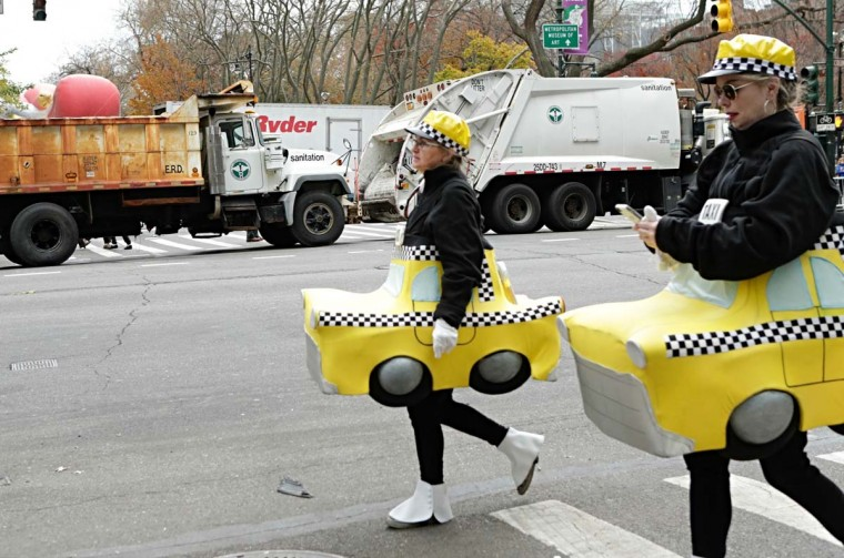 People in Customs arrive to the 90th annual Macy's Thanksgiving Day Parade as dump trucks block the streets on November 24, 2016 in New York. (KENA BETANCUR/AFP/Getty Images)