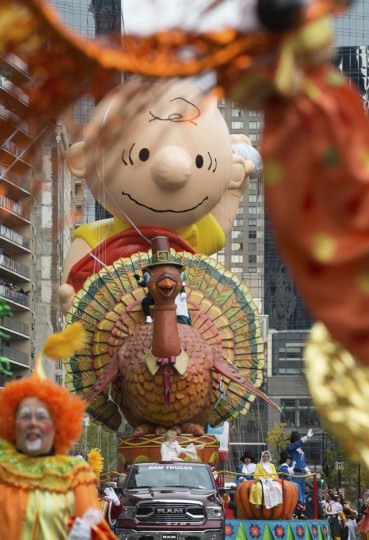 The Turkey float and Charlie Brown balloon move across Central Park South during the Macy's Thanksgiving Day Parade, Thursday, Nov. 24, 2016, in New York. (AP Photo/Bryan R. Smith)