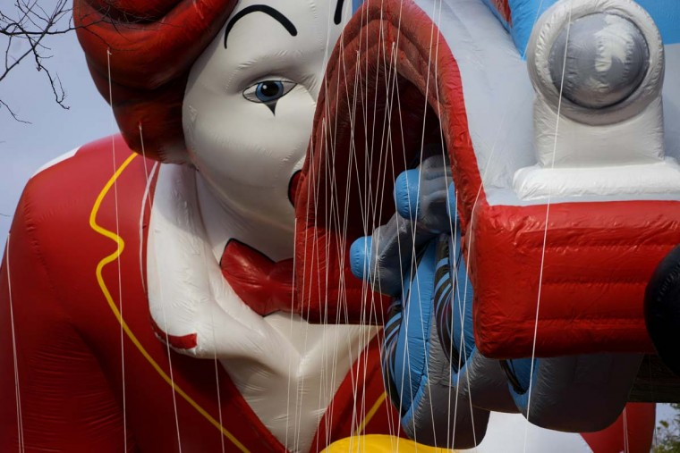 The Ronald McDonald and Thomas the Tank Engine balloons float over Central Park West during the Macy's Thanksgiving Day Parade in New York Thursday, Nov. 24, 2016. (AP Photo/Craig Ruttle)