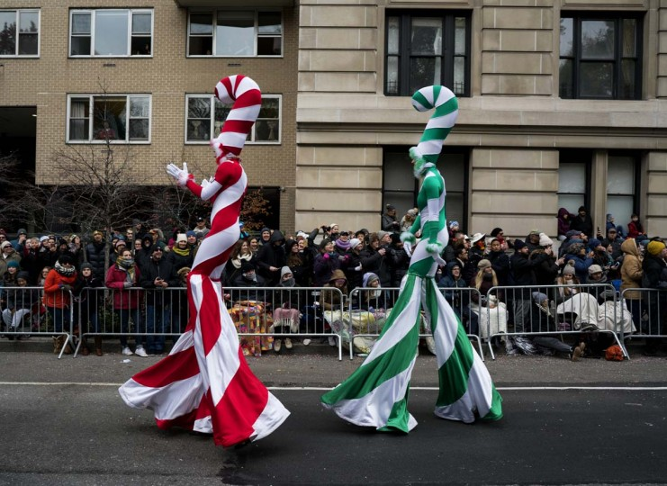 Participants stand tall above spectators along Central Park West during the Macy's Thanksgiving Day Parade in New York Thursday, Nov. 24, 2016. (AP Photo/Craig Ruttle)