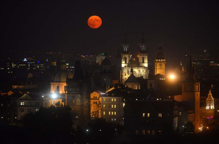 The supermoon rises above the Old Town square, on November 14, 2016 in Prague. The unusually big and bright moon appeared at its most impressive as night fell over Asia, but astronomy enthusiasts will be able to see Earth's satellite loom large anywhere in the world shortly after sunset. (MICHAL CIZEK/AFP/Getty Images)