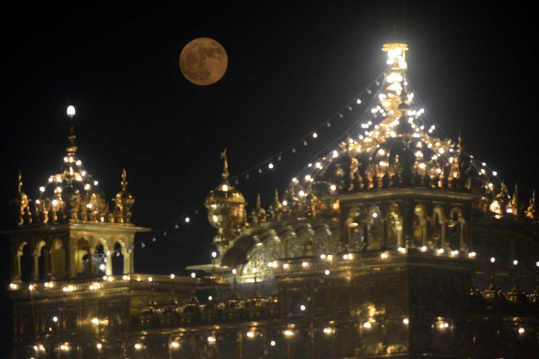 The 'supermoon' rises over the Sikh Shrine, the Golden Temple in Amritsar on November 14, 2016 Skygazers headed to high-rise buildings, ancient forts and beaches on November 14 to witness the closest 'supermoon' to Earth in almost seven decades, hoping for dramatic photos and spectacular surf. The moon will be the closest to Earth since 1948 at a distance of 356,509 kilometres (221,524 miles), creating what NASA described as 'an extra-supermoon. (NARINDER NANU/AFP/Getty Images)