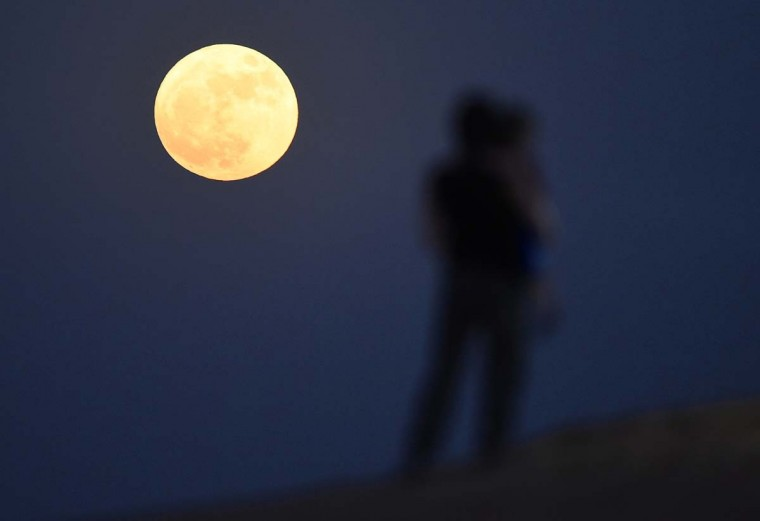 A 'supermoon' is pictured rising over the desert in Dubai on November 14, 2016 in Dubai, United Arab Emirates. A Supermoon occurs when the perigee (closest approach by the Moon to Earth) coincides with it being full (completely illuminated by the Sun). This time it will appear 7% larger and 15% brighter than normal. Although the next Supermoon will occur next month, the moon won't be this close to Earth again until November 2034. (Photo by Tom Dulat/Getty Images)