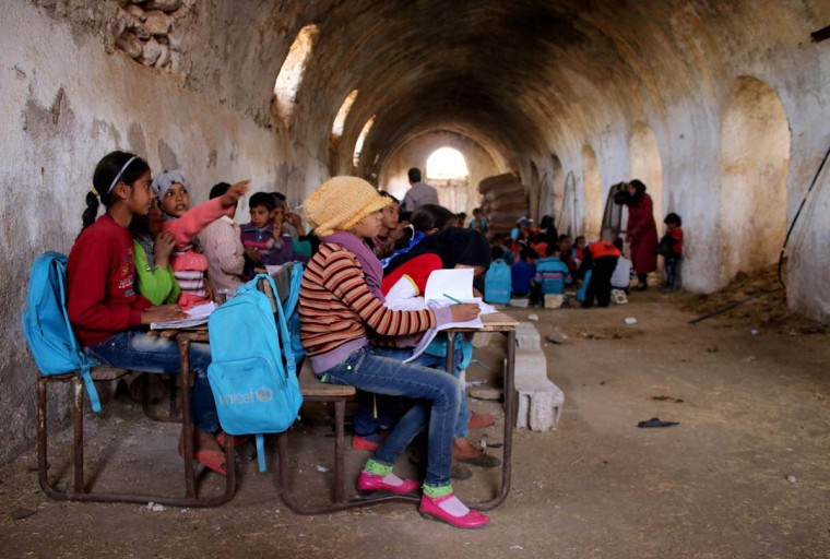 Syrian children sit during class a barn that has been converted into a makeshift school to teach internally displaced children from areas under government control, in a rebel-held area of Daraa, in southern Syria on November 10, 2016. Rebels hold most of Daraa province, but the regional capital is largely controlled by the government. (MOHAMAD ABAZEED/AFP/Getty Images)