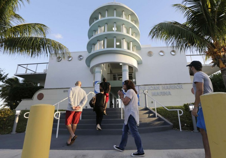 People line up to vote on Election Day, Tuesday, Nov. 8, 2016, at the Pelican Harbor Marina, in Miami. (AP Photo/Lynne Sladky)