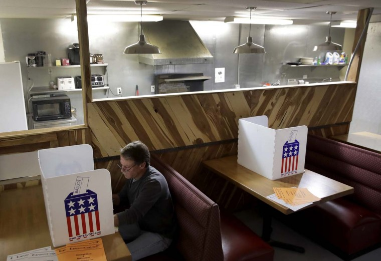 Kevin Cox, of Stockton, Mo., votes at the Caplinger Mills Trading Post Tuesday, Nov. 8, 2016, in Caplinger Mills, Mo. (AP Photo/Charlie Riedel)