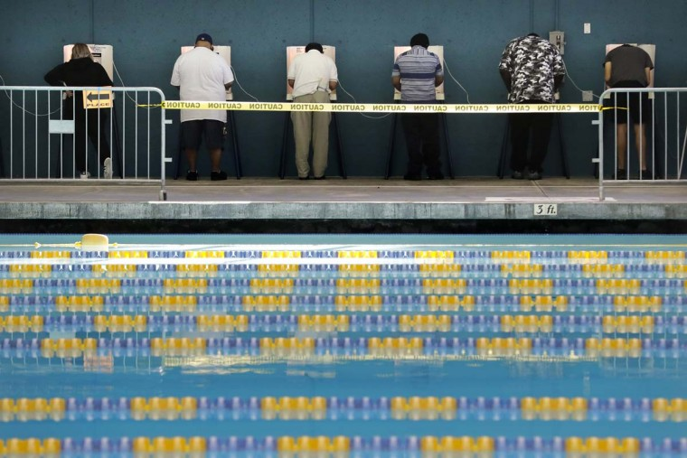People cast their votes at Echo Park Pool on Tuesday, Nov. 8, 2016, in Los Angeles. (AP Photo/Jae C. Hong)