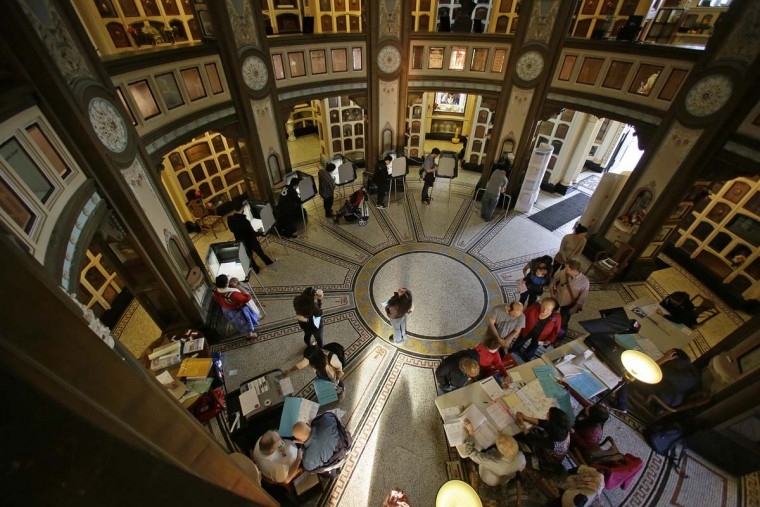 People line up to vote at the Neptune Society Columbarium Tuesday, Nov. 8, 2016, in San Francisco. Built in 1898, the columbarium is one of the last remaining cemeteries in San Francisco. (AP Photo/Eric Risberg)