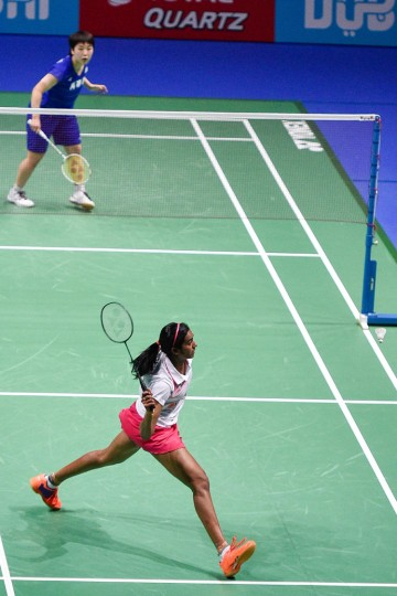 Pusarla V Sindhu of India plays a shot against Akane Yamaguchi of Japan (top) during their women's singles badminton match during the Dubai World Superseries Finals badminton tournament at the Hamdan Sports Complex in Dubai on December 14, 2016. (Stringer/AFP/Getty Images)