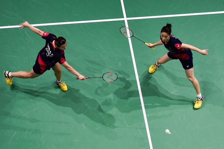Jung Kyung Eun and Shin Seung Chan of Korea play against Chen Qingchen and Jia Yifan of China during their women's doubles badminton match at the Dubai World Superseries Finals badminton tournament at the Hamdan Sports Complex in Dubai on December 14, 2016. (Stringer/AFP/Getty Images)