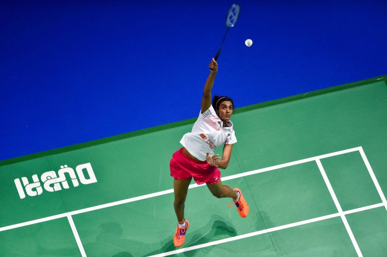 Pusarla V Sindhu of India plays a shot against Akane Yamaguchi of Japan during their women's singles badminton match during the Dubai World Superseries Finals badminton tournament at the Hamdan Sports Complex in Dubai on December 14, 2016. (Stringer/AFP/Getty Images)