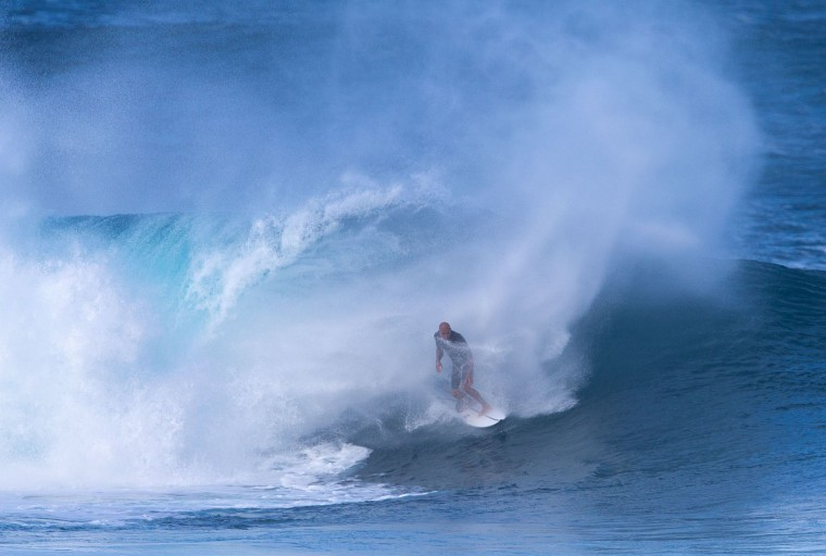 Eleven-time world surfing champion Kelly Slater of the US rides the waves on December 25, 2016 on the island of Oahu in Hawaii, following competition in Billabong Pipe Masters. Christmas Day at the pipeline was the best day of the winter season so far with huge tubes coming thru great surfing rides and heavy wipeouts with the worlds best surfers catching waves and dominating the pack. (Brian Bielmann/AFP/Getty Images)