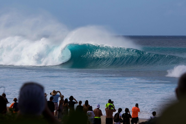 Spectators watch as the waves break on December 25, 2016 on the island of Oahu in Hawaii, following competition in Billabong Pipe Masters. Christmas Day at the pipeline was the best day of the winter season so far with huge tubes coming through great surfing rides and heavy wipeouts with the world's best surfers catching waves and dominating the pack. (Brian Bielmann/AFP/Getty Images)