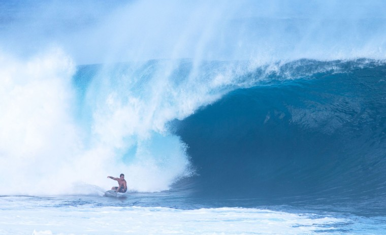 Felipe Ceserano of Brazil surfs on December 25, 2016 on the island of Oahu in Hawaii, following competition in Billabong Pipe Masters. Christmas Day at the pipeline was the best day of the winter season so far with huge tubes coming through great surfing rides and heavy wipeouts with the world's best surfers catching waves and dominating the pack. (Brian Bielmann/AFP/Getty Images)