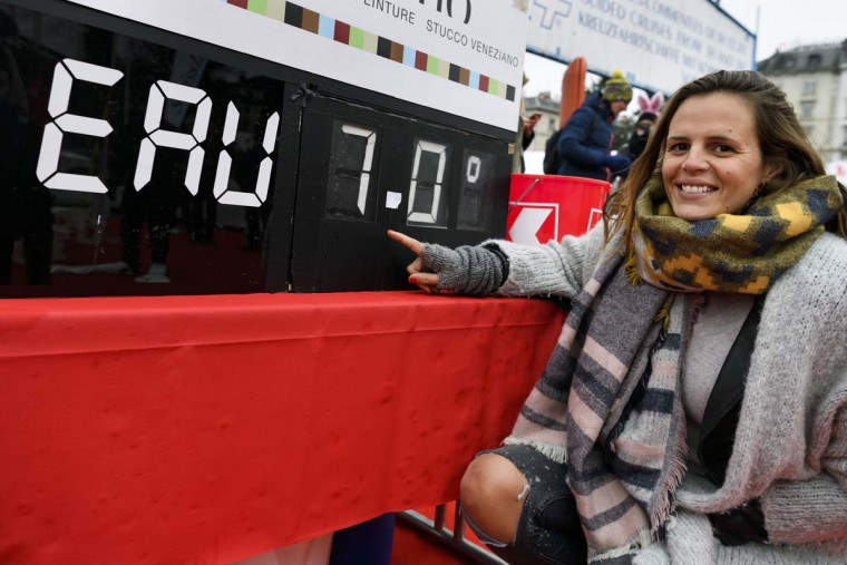 "Special guest, former swimmer French Laure Manaudou poses with a board showing the temperature of Lake Geneva during the 78th ""Coupe de Noel"" (Christmas cup) swimming race, on December 18, 2016 in Geneva. More than 1800 participants took part to the event, a 120-meter-long swimming off the Geneva's bank in the 7 degrees Celsius cold water. (FABRICE COFFRINI/AFP/Getty Images)"