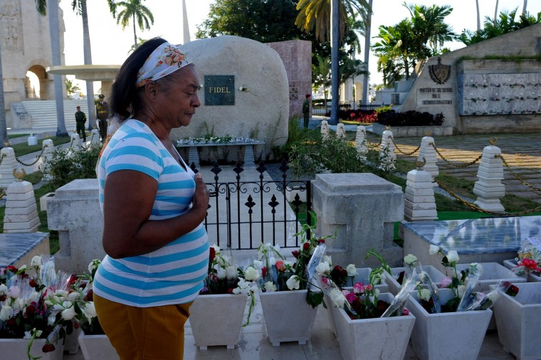 Cubans visit Fidel Castro's tomb at the Santa Ifigenia cemetery in Santiago de Cuba on December 4, 2016. Fidel Castro's ashes were buried alongside national heroes in the cradle of his revolution, as Cuba opens a new era without the communist leader who ruled the island for decades. (Yamil Lage/AFP/Getty Images)