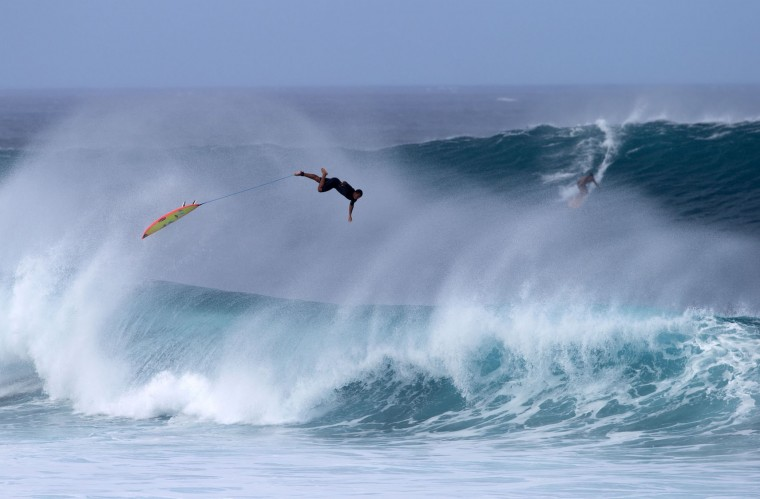 An unidentified surfer wipes out on December 25, 2016 on the island of Oahu in Hawaii, following competition in Billabong Pipe Masters. Christmas Day at the pipeline was the best day of the winter season so far with huge tubes coming through great surfing rides and heavy wipeouts with the world's best surfers catching waves and dominating the pack. (Brian Bielmann/AFP/Getty Images)