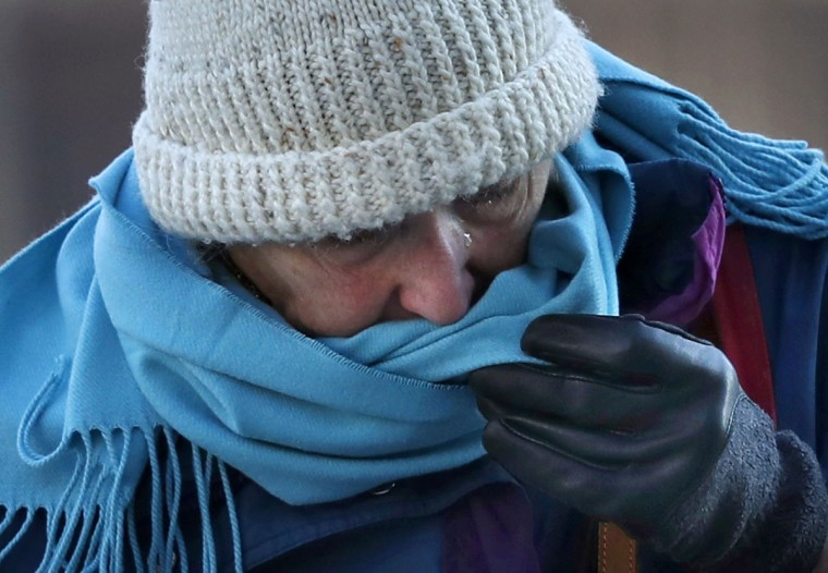 A woman uses her scarf to wipe away a tear brought on by frigid weather, Thursday, Dec. 15, 2016, in Portland, Maine. Much of the northern Mid-Atlantic and Northeast will stay cold for the next couple of days as the arctic air remains stuck over the northern Appalachians, the National Weather Service said. (AP Photo/Robert F. Bukaty)