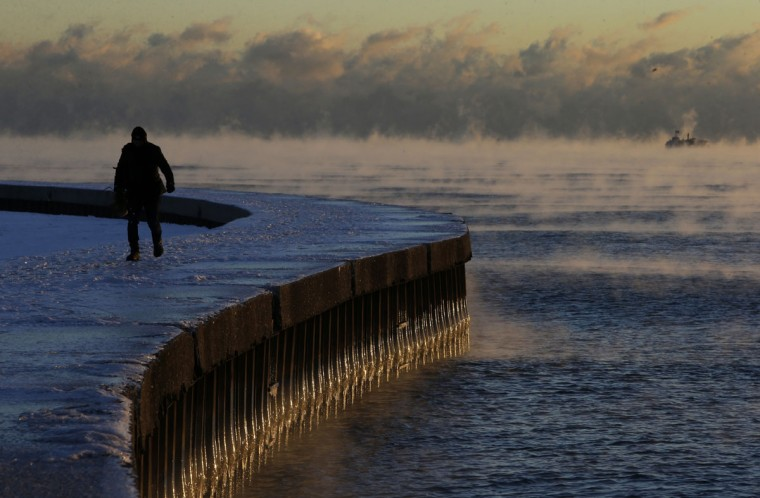 Steam rises up on the surface of Lake Michigan at sunrise, Thursday, Dec. 15, 2016, in Chicago. Dangerously cold temperatures gripped the Upper Midwest in advance of a storm that's expected to bring several inches of snow in coming days, while schools and officials in the Northeast braced for their own blast of wintry weather. (AP Photo/Kiichiro Sato)