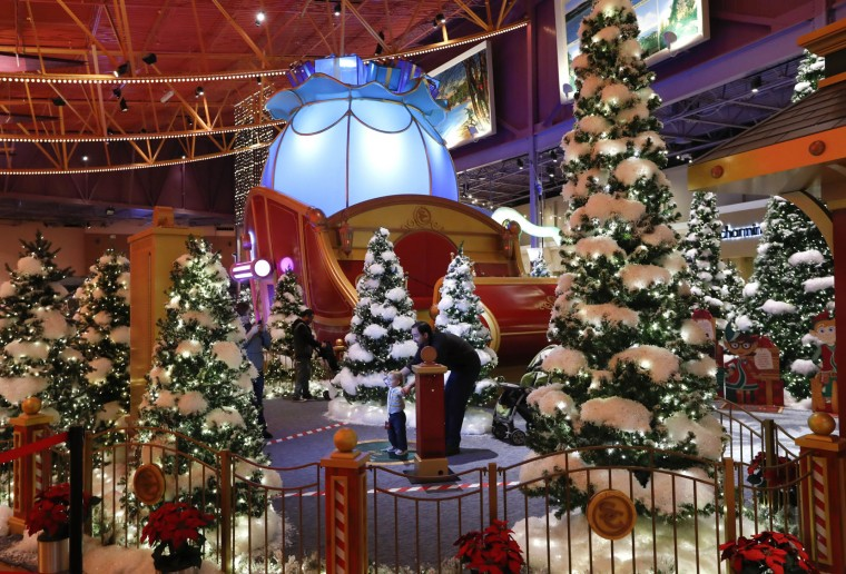 This Monday, Nov. 21, 2016, photo, shows Santa's Flight Academy in Great Lakes Crossing Outlets in Auburn Hills, Mich. In an effort to lure online shoppers to their stores, many malls are upgrading the traditional visit to Santa into a high-tech spectacle. (AP Photo/Paul Sancya)